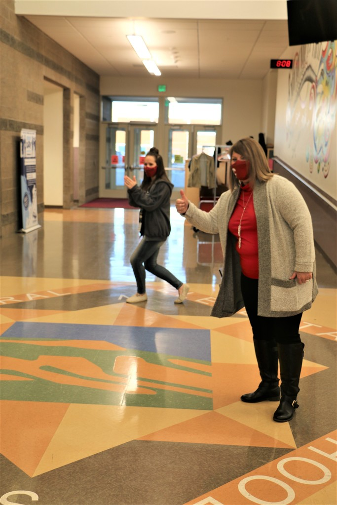 Central School Principal Suzy Mayes and School Counselor Jennifer Slippy  welcome students as they come through the door.